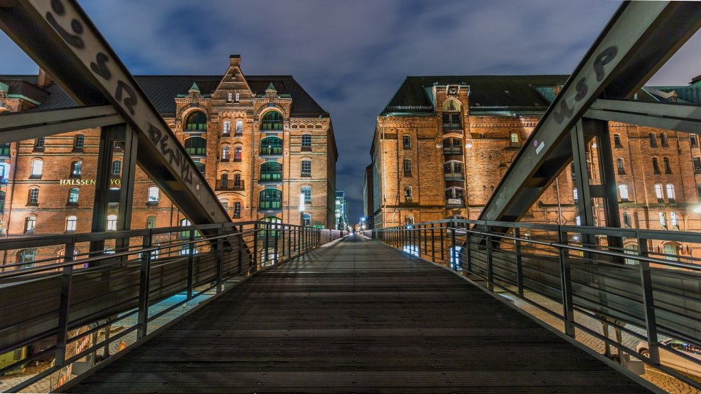 Bridge leading to apartment buildings.